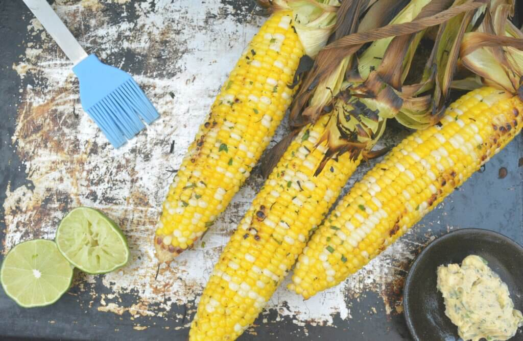 Grilled corn for renal diet with low sodium herbed butter and limes