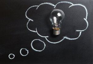 lightbulb on chalkboard to emphasize bulletin board ideas