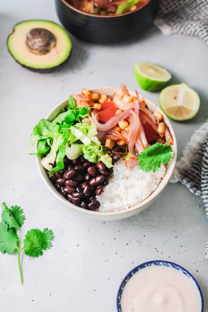 Top view meal prep burrito bowl with avocado and cilantro- plant based kidney